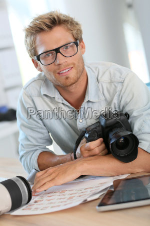 portrait of young photographer reporter in