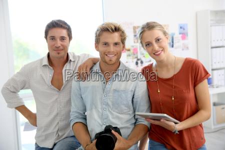portrait of cheerful creative team in