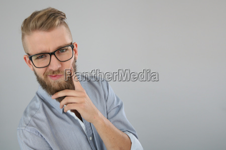 young man with beard having a
