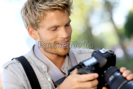 photographer checking shots on camera screen