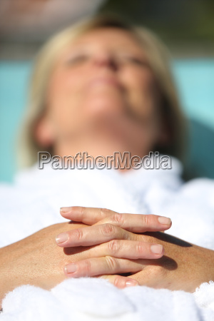 closeup on womans hand relaxing by
