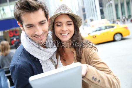 couple looking at new york city