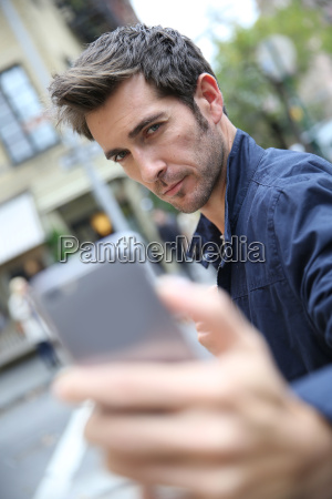 man making selfy with smartphone in