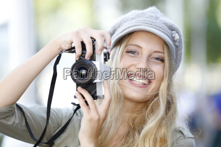 trendy, girl, taking, pictures, with, vintage - 17817166
