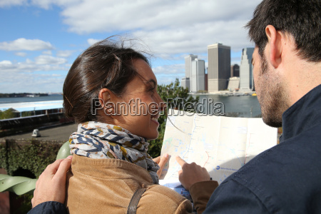 couple reading city map of new
