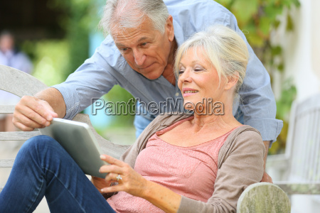 senior couple websurfing on internet with