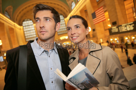couple in grand central station reading