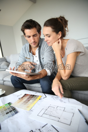 couple searching ideas to decorate new