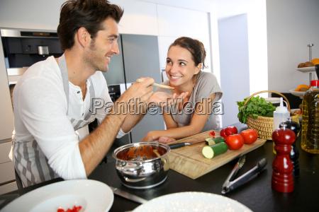 man having his wife tasting pasta