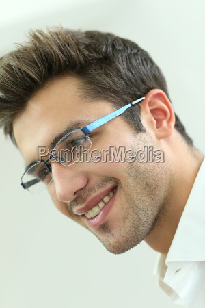 portrait of young man wearing eyeglasses