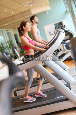 couple in fitness center working out