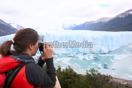 tourist taking picture of perito moreno