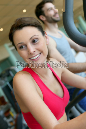 woman in fitness club using cardio