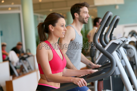 couple doing cardio training program in