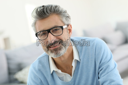 smiling mature man with grey hair