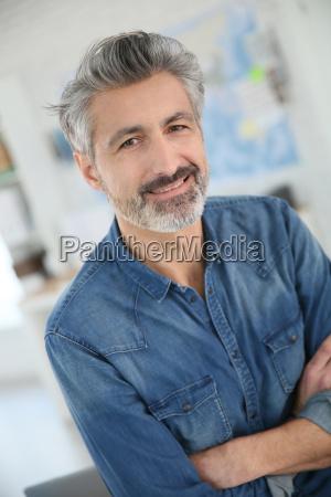 portrait of smiling mature teacher in