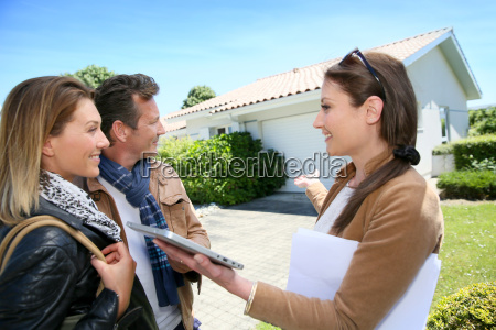 real estate agent presenting house to