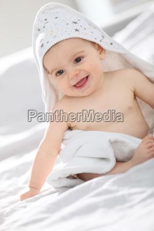 baby boy withbath towel over him
