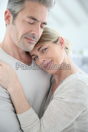 mature couple embracing with love and