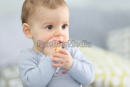 portrait of cute baby boy eating