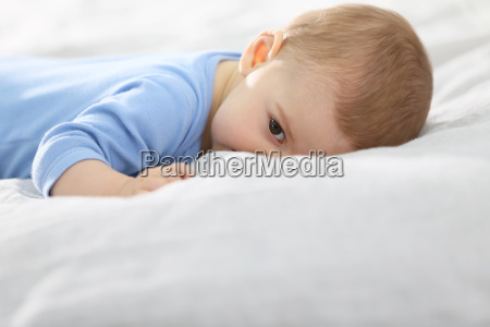 8 month old baby boy laying