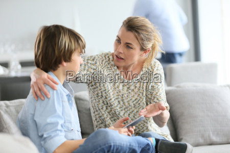 mother giving warning to young boy