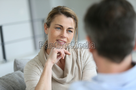 couple at home sitting in sofa