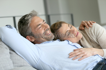 mature couple relaxing in sofa peaceful