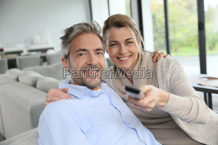 middle aged couple in living room
