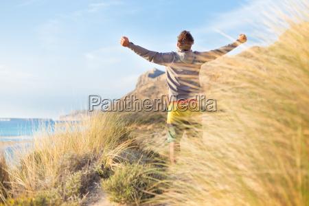 free active man enjoying beauty of