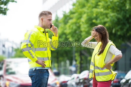 couple calling on mobile phone near