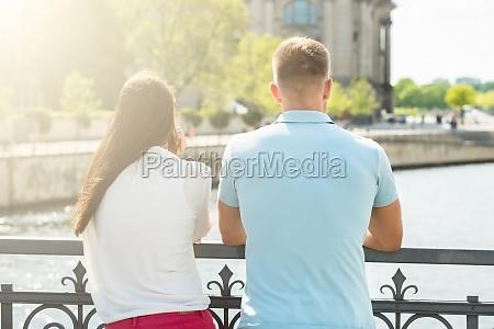 man and woman enjoying view