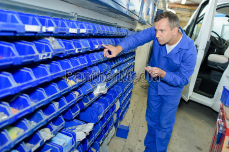 man selecting part from racking