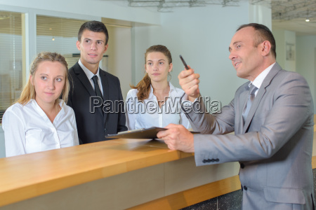 hotel, staff, following, supervisor's, gaze - 17856726