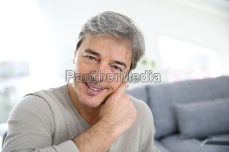 portrait of mature man relaxing at