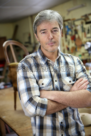 portrait of craftsman in workshop