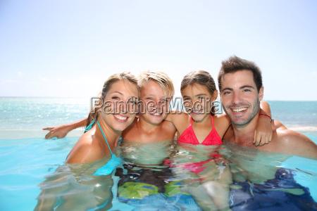 happy family enjoying bath time in