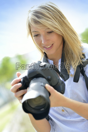 portrait of young woman photographer