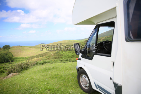 view of camper parked on hill