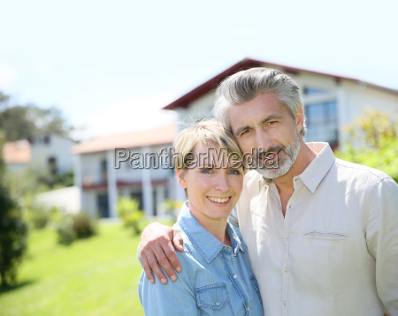 couple standing in front of newly