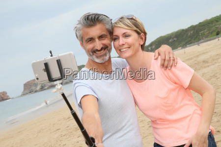 couple taking picture with smartphone and