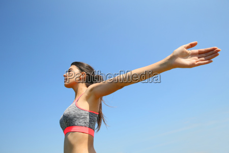 brunette fitness girl stretching arms out