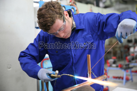 student in plumbing professional training working