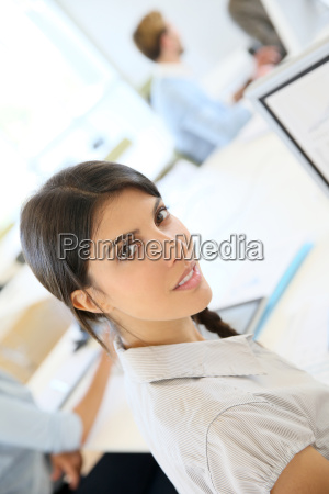 portrait of young brunette woman working
