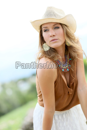 attractive woman model with cowgirl style