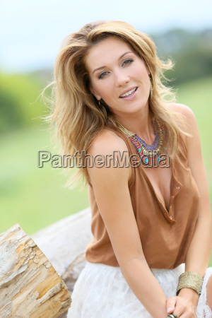 attractive model woman sitting on old