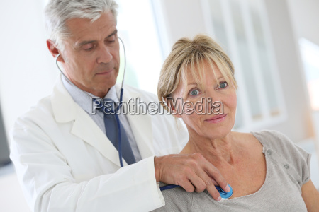 senior woman in doctors room for