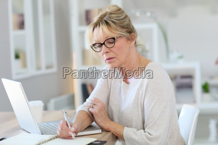 portrait of senior woman working on