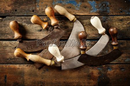 collection of vintage italian mezzaluna knives