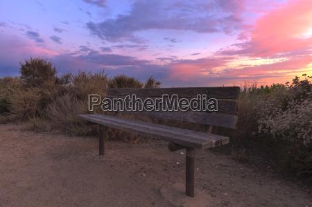 boardwalk bench at crystal cove beach